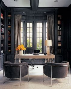 Elle Decor-  These barrel chairs look perfect in this office!!!  We have a chic pair of barrel chairs, in a midnight blue velvet with burl wood trim.  Amazing!!! www.vintagegrain.com