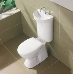 These toilets are popular in Japan - Awesome way to save water!! When you flush, the tank fills by way of the faucet so that you use the water twice (once for hand washing and once for your future flush!)
