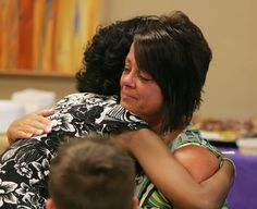 Heart transplant patient Melody McIntosh, left, hugs Kelly Swart -- mother of Ashley Swart, who donated her heart -- during a meeting Monday at Advocate Condell Medical Center in Libertyville. Swart was a 20-year-old Purdue student who died suddenly in 2013; she donated several organs including the heart that saved McIntosh.