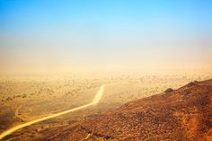 Atar, Mauritania  The Sahara, as seen from the Adrar hills/mountains near Atar in Mauritania. As far as you can see, there's just yellow, orange, red and blue. An incredible sight, beautiful and scary at the same time.
