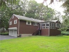 19 Thompson Street, Shelton, CT 06484 — Oversized Raised Ranch With Finished Lower Level has 2 Fireplaces, Heated Inground Pool, Oversized Detached 1-2 Car garage and is Set On Level .96 Acre In Huntington