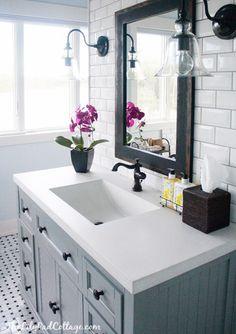 gray vanity, clear glass, subway tile bathroom sconces