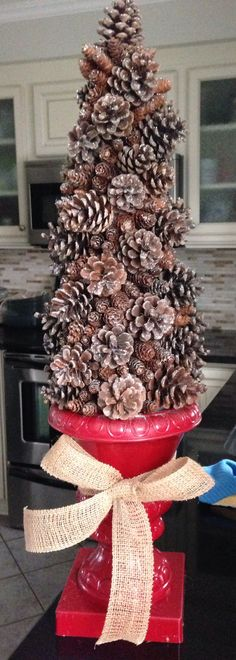 Diy pine cone tree: vase of choice, styrofoam cone, glittered pine cones and hot glue.