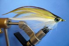 Beautifully tyed saltwater baitfish fly.  The oversized eyes add to its effectiveness.