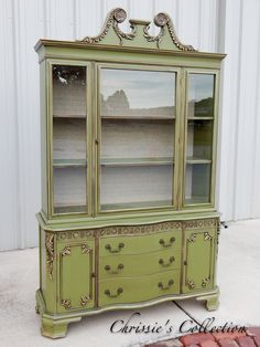 """Ornately carved mahogany china cabinet. Multi layered, antiqued finish. 50""""x17"""" and 80""""t. Painted by Chrissie's Collection. $525"""
