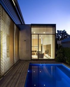The structure emphasises low-maintenance living, from its light-filled lounge area to its pool and deck. Picture: Hilary Bradford.