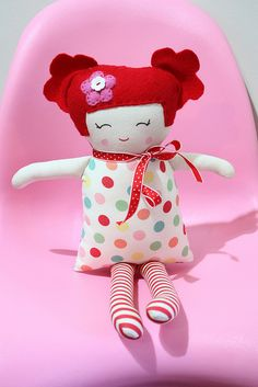 Black apple doll made with fluffy pigtail hair