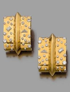 A magnificent and rare pair of clip brooches, designed by Suzanne Belperron, circa 1935. Each of rectangular form, highlighted with a central peal and set with brilliant-cut, baguette and triangular diamonds, mounted in 18k gold and platinum. With a Groene et Darde hallmark.