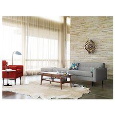 Gray sofa, concrete floors, cowhide rug