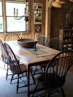 The Wool Cupboard: dining table, windsor chair and candelabra
