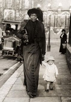 """This is Mme Abomah aka """"The African Giantess."""" (Her birth name was Ella Williams). She was an international celebrity and the tallest woman (7'6″) in the world during her time."""