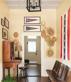Instead of offering the traditional entryway bench, the owner of this colorful Texas home invites guests to take a load off on vintage seating from the original General Motors auditorium—a shopping score from Detroit.    - CountryLiving.com