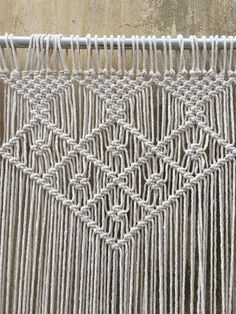 Ready to ship Wedding Backdrop / Large Macrame Wall Hanging. Width- 228cm (90 inch) Length- 175cm (70 inch) We also have 2 chair hangers of the same design if you are going to use this at your wedding ceremony. Handmade Macrame wall decor as a Headboard in bedroom or as a Dropback at the weddings... Great boho focus point in living rooms... This beautiful item made with 100% cotton rope. We are also happy to provide custom order for this... Please let us know your measurements and we wil...