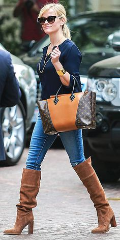 Jeans and a T-shirt is every starlet's go-to uniform. How's a girl to stand out in a sea of celebrity street style? Reese gets your attention by adding a killer pair of over-the-knee Michael Michael Kors boots (though the rest of her accessories aren't too shabby, either).