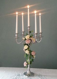 Silver Candelabra Wrapped with Roses and Ivy - Pretty! Candelabra Wedding Centerpieces, Candelabra Flowers, Reception Decorations, Table Decorations, Silver Candelabra, Wedding Table, Our Wedding, Wedding Ideas, Centre Pieces