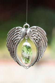 REFLECTIONS™ Angel wing memorial suncatcher. Add ashes or hair to your custom bead. Cremains from cat, dog, people, custom urn bead