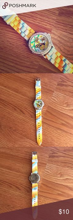 Butterfly watch with rubber wrist band This pretty watch features diamonds around the face and a multi colored rubber wristband. Needs a battery. Like new! 💖 Make an offer or add to a bundle for 20% off! Accessories Watches
