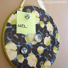 Dollar store burner cover turned magnetic message board. You could also use a cookie sheet.