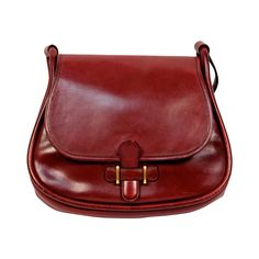 1974 HERMES burgundy box leather saddle bag with gold hardware | From a collection of rare vintage shoulder bags at https://www.1stdibs.com/fashion/handbags-purses-bags/shoulder-bags/