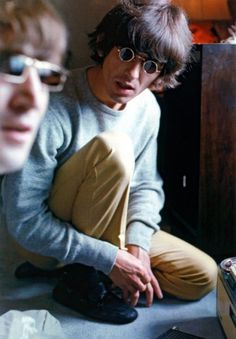 John Lennon and George Harrison passing time at the Tokyo Hilton, 1966.  The Beatles did not have many opportunities to sightsee in the countries they toured.