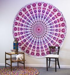 """From bedding to beach blanket and everything in between these tapestries are just what you need to add a little burst of color to your life. Each of them are handmade by our artisans in India and the vibrant blues, purples, pinks and greens are truly mesmerizing. These come in 4 different Mandala and Medallion patterns The detail on each of these tapestries shows off the handiwork and love poured into them. <3  Material: 100% Cotton  Dimensions: Peacock Pride - 90"""" x 79"""" Indian Sunrise - 90""""…"""