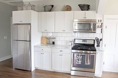 Elizabeth Burns Design | Budget Farmhouse Kitchen Renovation Fixer Upper - white shaker cabinets, Formica® 180fx® Calacatta Marble counter, subway tile, sherwin williams silver strand   Click through to order your free sample of Calacatta Mable 180fx®
