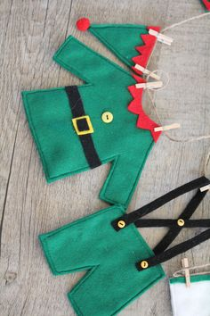 This was designed & handcrafted by me. This Elfs Washing Line, is an original Christmas garland that would look great on the wall, over a mantelpiece or dresser or hung with your Christmas stockings. There are 12 items of clothing hand crafted in felt Elf Christmas Decorations, Christmas Bunting, Felt Decorations, Felt Christmas Ornaments, Christmas Sewing, Christmas Crafts For Kids, Xmas Crafts, Christmas Elf, Homemade Christmas