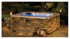 Hot Spring SpaStone Full Surround. It brings a stone look to an above-ground installation. IHT 303-296-7727.  http://ihtspas.com/custom-cabinets.php