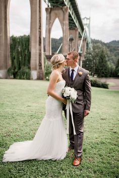 Bride & Groom Share Kiss at Park | Photo: Studio 623 Photography. View More:  http://www.insideweddings.com/weddings/simple-rustic-park-wedding-with-diy-details-in-portland-oregon/894/