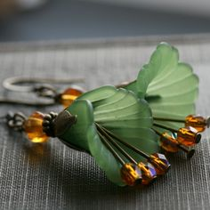 Green lucite and amber glass flower earrrings - lovely colour combination.
