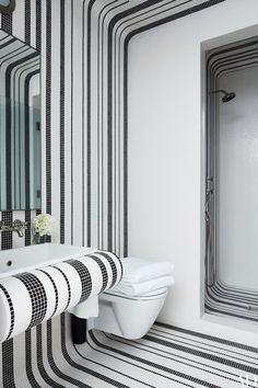In a New York townhouse decorated by Delphine Krakoff a guest bath is sheathed in Bisazza tile | archdigest.com