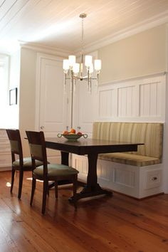 The paint color is Ancient Marble by Sherwin Williams.  Kitchen banquette - Raleigh - Abode Interiors