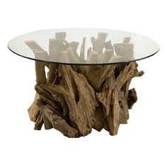 Naturally shaped teak wood base and round glass top,