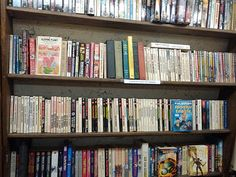 From John: The last half of the first shelf and the first half of the second shelf are all Edgar Rice Burroughs books, to give you an idea of Von's selection. If they don't have something, it's probably because I bought it.