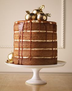Vanilla-bean spiced apple cake filled with caramel buttercream and drizzled with luscious caramel. Yes please.
