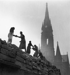 'Trümmerfrau(literally translated asruins womanorrubble woman) is the German-language name for women who, in the aftermath ofWorld War II, helped clear and reconstruct the bombed cities ofGermanyandAustria.    Between1945and1946, theAllied powers, in bothWest GermanyandEast Germany, ordered all women between 15 and 50 years of age to participate in the postwar cleanup.'