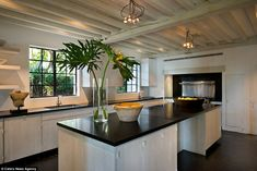 The large kitchen features quirky artwork along with minimalist lighting...