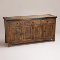 I really like this for a Buffet in the Dining room under the windows if it fits.  Clayton Rustic Sideboard - World Market.  LOVE world market!