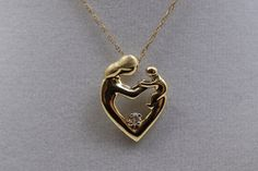 14K Vintage Mother and Child diamond pendant by TheHavenFinds
