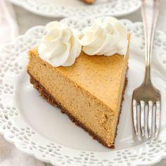 A smooth and creamy pumpkin cheesecake sits on top of an easy homemade gingersnap cookie crust. The gingersnaps in the cookie crust just takes this pumpkin cheesecake over the top! It is the perfect dessert for fall! Pumpkin Cheesecake Recipes, Baked Cheesecake Recipe, Cheesecake Desserts, Pumpkin Recipes, Fun Desserts, Dessert Recipes, Holiday Desserts, Dessert Ideas, Food Cakes