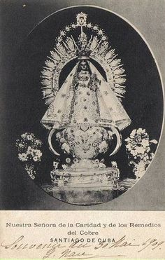 Nuestra Señora de la Caridad y de los Remedios del Cobre  A photograph from the early 20th century of Our Lady of Charity, the patroness of Cuba.