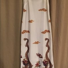 Dress with oriental dragon Oriental homemade dress with dragons on bottom of the dress. Runs about a suze small to a medium. Dresses Maxi