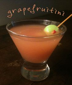 "Recipe : Grapefruitini with Honeydew Melon and Strawberry ""Olives""  These honeydew melon and strawberry ""olives"" are a great summer garnish for nearly any libation!"