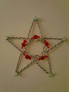 $Tree star ornament - $2 for 2 bags plastic candy canes,  $1 or 2 extra if you don't already have the mints ( hot glue works best)