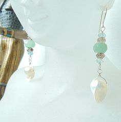 """Drawing upon a fresh ocean breeze in the still of morning, these elegant dangles will sure to be a beautiful addition to nearly any wardrobe.  As my daughter says, """"Reminds me of a pure angel"""".  All wire used is genuine .925 sterling silver with handmade french hooks.    -aquamarine A/B quality  -A grade smoky quartz  -soft green adventurine facets  -genuine sterling silver wire and french hooks      All of your items will come polished, and packed with their own little keepsake drawstring…"""