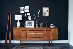 mid-century modern dresser on dark wall with decorative prints   #thefamilymark www.thefamilymark.com