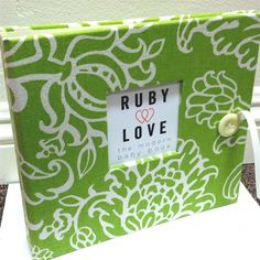 maybe this one? want to find a fun baby book!! Ruby Love Modern Baby Book . Green Serafina Floral Album. $60.00, via Etsy.