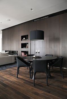 A Private Residence, Helinski by Interior Architect Joanna Laajisto. Dark and moody contemporary apartment. Timber Panel. Lounge room. Minimalist Style. Kitchen Design, Bathroom Design. /// The Joanne Green Blog