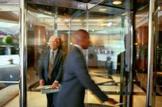 Who invented the revolving door? Find out here and if the rumor is true that the revolving door inventor didn't want to hold a door open for anyone. Child Protective Services, Revolving Door, Succession Planning, Swinging Doors, Restaurant Branding, Heating And Cooling, Energy Efficiency, Project Management, Inventions