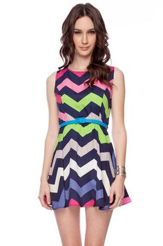 Gahh I love this!! Such a pretty spring dress. Miss Ziggy Belted Dress in Navy Multi $30 at www.tobi.com